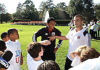 "Andy Najar and Chris Megaloudis during a  D.C United clinic in support of first lady Michelle Obama's ""Let's Move"" initiative on the White House lawn, in Washington D.C. on October 7 2010."
