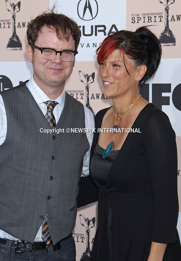 """RAINN WILSON AND HOLIDAY REINHORN.INDEPENDENT SPIRIT AWARDS.Santa Monica, California_26/2/2011.Mandatory Photo Credit: ©M.Philips_Newspix International..**ALL FEES PAYABLE TO: """"NEWSPIX INTERNATIONAL""""**..PHOTO CREDIT MANDATORY!!: NEWSPIX INTERNATIONAL(Failure to credit will incur a surcharge of 100% of reproduction fees)..IMMEDIATE CONFIRMATION OF USAGE REQUIRED:.Newspix International, 31 Chinnery Hill, Bishop's Stortford, ENGLAND CM23 3PS.Tel:+441279 324672  ; Fax: +441279656877.Mobile:  0777568 1153.e-mail: info@newspixinternational.co.uk"""