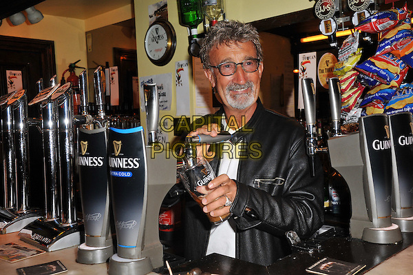 Eddie Jordan .Charismatic Formula 1 personality Eddie Jordan overjoyed with an honorary OBE in recognition for his services to charity and motor racing and drinks a celebratory pint of Guinness at the Toucan Bar, Soho, London, England..March 28th, 2012.half length glasses goatee facial hair drink beverage alcohol white black leather jacket .CAP/BF.©Bob Fidgeon/Capital Pictures.