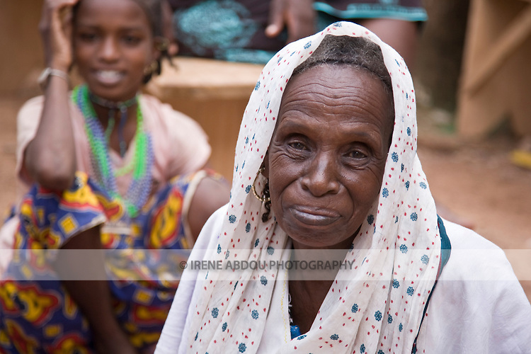 Binta Moussa, a Fulani woman from the Djibo area of eastern Burkina Faso, and her granddaughter visit relatives in the capital city of Ouagadougou.