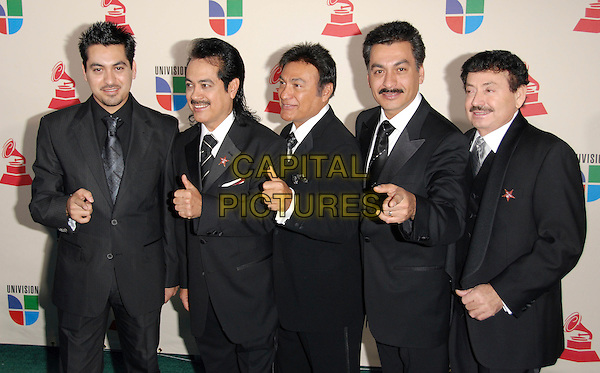 LOS TIGRES DEL NORTE.The 8th Annual Latin Grammys held at The Mandalay Bay Hotel & Casino in Las Vegas, California, USA..November 8th, 2007.half length black suit jacket thumb up hand moustache mustache facial hair.CAP/DVS.©Debbie VanStory/Capital Pictures