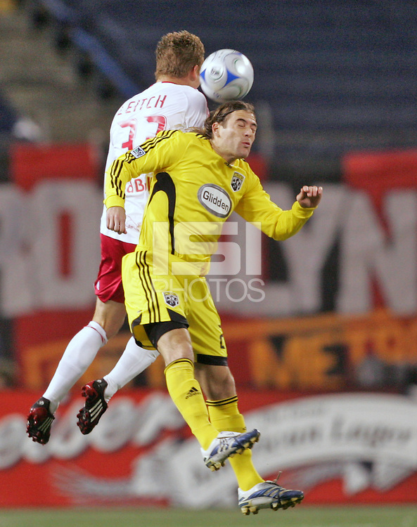 New York Red Bulls' Chris Leitch, left, fights Columbus Crew's Nicolas Hernandez for a header during the first half of an MLS soccer match at Giants Stadium in East Rutherford, N.J. on Saturday, April 5, 2008.