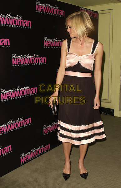 JENNI FALCONER.Inside Arrivals at the New Woman Beauty Awards 2006, The Dorchester Hotel, London, England, April 11th 2006..full length peach pink and black satin dress striped stripes straps waist belt ribbons clutch bag.Ref: CAN.www.capitalpictures.com.sales@capitalpictures.com.©Can Nguyen/Capital Pictures