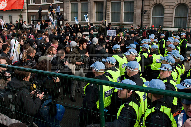 After marching along Whitehall protesters find their way blocked by members of the Metropolitan Police's Territorial Support Group (TSG).  A further police line meant demonstrators of all ages were kept on Whitehall for several hours. 24/11/2010