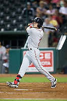 Andrew Benintendi (2) of the Greenville Drive follows through on his swing against the Greensboro Grasshoppers at NewBridge Bank Park on August 17, 2015 in Greensboro, North Carolina.  The Drive defeated the Grasshoppers 5-4 in 13 innings.  (Brian Westerholt/Four Seam Images)