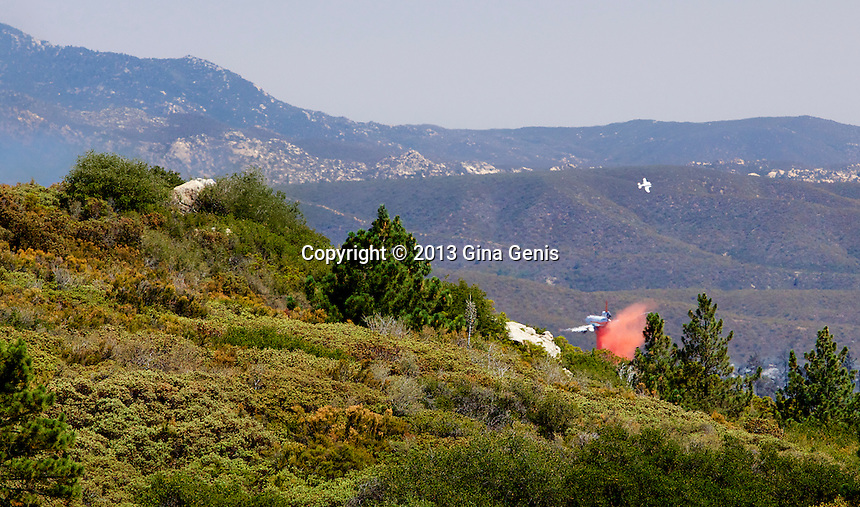 A DC 10 drops fire retardant over the Apple Canyon area of Mountain Center on July 16, 2013.