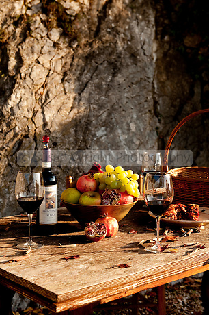Red wine from the Montefalco region in Umbria, on table in garden, Umbria, Italy