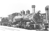 Right 3/4 view of K-27 #454 with engine coupled to another engine.<br /> D&amp;RGW  Alamosa ?, CO