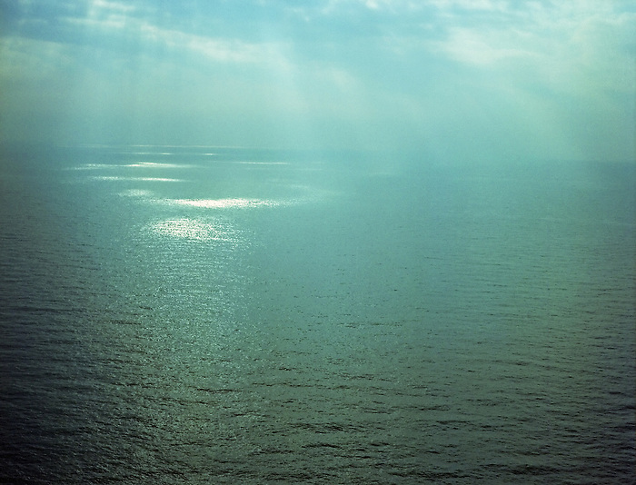 Beams of sunlight on the surface of the sea.