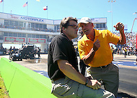 Sept. 21, 2013; Ennis, TX, USA: Texas governor Rick Perry (left) talks with track owner Billy Meyer on the starting line during NHRA qualifying for the Fall Nationals at the Texas Motorplex. Mandatory Credit: Mark J. Rebilas-