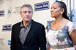 "Robert Deniro and his wife, Grace Hightower, at Woody Allen's new movie ""Whatever Works"" premiered April 22, 2009 at the Tribeca Film Festival - Ziegfeld Theatre, New York."