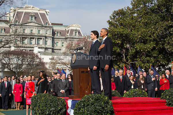 U.S. President Barack Obama (R) welcomes Prime Minister of Canada Justin Trudeau (L) at an arrival ceremony on the South Lawn of the White House, in Washington, DC, USA, 10 March 2016. This is the first official visit of Prime Minister of Canada Justin Trudeau to the White House. <br /> Credit: Jim LoScalzo / Pool via CNP/MediaPunch