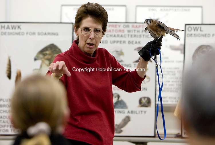 WINSTED, CT- 05 APRIL 07- 040507JT04-- <br /> Julie Anne Collier of Wingmasters, a group based in Massachusetts to increase public understanding and appreciation of North American birds of prey, presents a male American Kestral to an audience at Northwestern Connecticut Community College in Winsted on Thursday evening.<br /> Josalee Thrift Republican-American