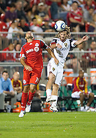 28 August 2010: Real Salt Lake midfielder Kyle Beckerman #5 and Toronto FC forward Dwayne De Rosario #14 in action during a game between Real Salt Lake and Toronto FC at BMO Field in Toronto..The game ended in a 0-0 draw..