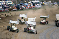 Steve Kinser (11) and Sammy Swindell lead a field of cars during the 1979 World of Outlaws race at Eldora Speedway, Rossburg, Ohio.