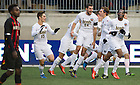 Dec. 15, 2013; Notre Dame forward Leon Brown (right) celebrates with teammates after he scored against Maryland in the first half of College Cup finals at PPL Park in Chester, Pa. Photo by Barbara Johnston/University of Notre Dame