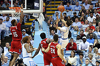 CHAPEL HILL, NC - FEBRUARY 25: Cole Anthony #2 of the University of North Carolina shoots over Manny Bates #15 of North Carolina State University during a game between NC State and North Carolina at Dean E. Smith Center on February 25, 2020 in Chapel Hill, North Carolina.