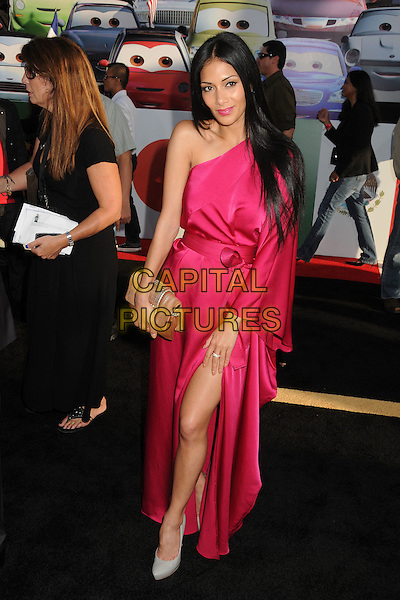 "Nicole Scherzinger.""Cars 2"" Los Angeles Premiere held at the El Capitan Theatre,  Hollywood, California, USA, 18th June 2011..full length pink dress one shoulder sleeve long maxi silk satin slit split  beige clutch bag leg thigh white grey gray shoes .CAP/ADM/BP.©Byron Purvis/AdMedia/Capital Pictures."