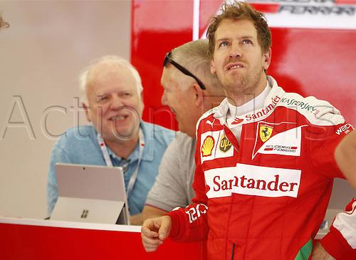 01.04.2016. Bahrain. FIA Formula One World Championship 2016, Grand Prix of Bahrain, Practise day.  Norbert Vettel (GER), 5 Sebastian Vettel (GER, Scuderia Ferrari)