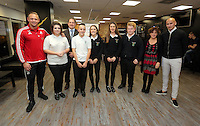 Pictured: Lee Trundle and Jonjo Shelvey pose with pupils from Llangatwck Community SchoolWednesday 25 November 2015<br />