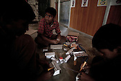 Students sit together and work on a model making project during a special class in a government run school in Caregaon, Thane, Maharashtra. These schools run a specially designed concept of 'aflatoon' as part of the curriculam whereby students are made aware of their child as described in the convention of rights of child. These students are made aware of right to survival, right to protection, right to development and right to participation.