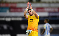 Lincoln City's Grant Smith applauds the fans at the final whistle<br /> <br /> Photographer Chris Vaughan/CameraSport<br /> <br /> The Carabao Cup First Round - Huddersfield Town v Lincoln City - Tuesday 13th August 2019 - John Smith's Stadium - Huddersfield<br />  <br /> World Copyright © 2019 CameraSport. All rights reserved. 43 Linden Ave. Countesthorpe. Leicester. England. LE8 5PG - Tel: +44 (0) 116 277 4147 - admin@camerasport.com - www.camerasport.com