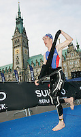 02 SEP 2007 - HAMBURG, GER - Matt Hammerton (GBR) takes off his wetsuit on the long run to transition - World Age Group Triathlon Championships. (PHOTO (C) NIGEL FARROW)