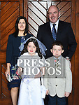 Zoe McFadden who recieved first holy communion in the church of Mary Immaculate collon pictured with parents Chris and Sinead and brother Daniel. Photo:Colin Bell/pressphotos.ie
