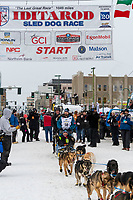 Quince Mountain and team leave the ceremonial start line with an Iditarider and handler at 4th Avenue and D street in downtown Anchorage, Alaska on Saturday March 7th during the 2020 Iditarod race. Photo copyright by Cathy Hart Photography.com