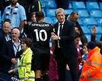 Roy Hodgson manager of Crystal Palace consoles Andros Townsend of Crystal Palace as he troops off to a 5-0 loss during the premier league match at the Etihad Stadium, Manchester. Picture date 22nd September 2017. Picture credit should read: Simon Bellis/Sportimage