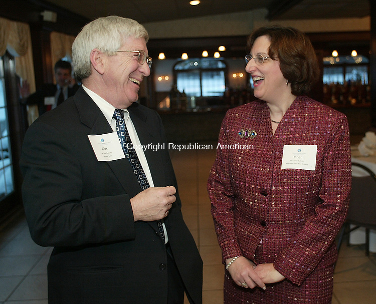 SOUTHINGTON, CT - 01 March 2005 -030105BZ07-  From left- Alex Bequary, V.P. of Small Business and Business and Professional Services at Webster Bank; and Janet Sullivan, commercial real estate lender for Sovereign Bank New England;<br /> talk during the State of the State Legislative dinner at the Aqua Turf in Southington Tuesday night.  <br /> Jamison C. Bazinet Photo
