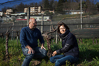 "Switzerland. Canton Ticino. Cagiallo. Merlot wineyard ""Viva Dobbiamo"". Two winemakers Sacha Pelossi (L) and  Valentina Andrei (R). The Swiss rock band Gotthard is associated with winemakers Valentina Andrei (Merlot Ivresse from Valais) and Sacha Pelossi (Merlot from Ticino) to create the new vintage bottle: Magnificents' 17. Cagiallo is a village and and is part of the Capriasca municipality. 25.03.2019 © 2019 Didier Ruef"