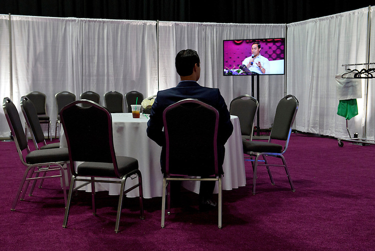 UNITED STATES - AUGUST 30: Mayor of San Antonio Julian Castro watches his brother Rep. Joaquin Castro, D-Texas, participate on an education panel discussion, during the Festival People en Espanol, an event that celebrates hispanic entertainment, held at the Henry B. Gonzalez Convention Center in downtown San Antonio. (Photo By Tom Williams/CQ Roll Call)