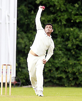 Manhar Patel bowls for Harrow Town during the ECB Middlesex Division Three game between Highgate and Harrow Town at Park Road, Crouch End on Saturday May 24, 2014