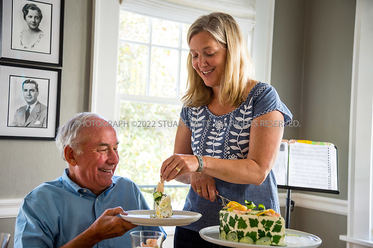 8/22/2016-- Seattle, WA, USA<br /> <br /> <br /> Sarah Gannholm, 48, serving Smorgastorta, an elaborate Swedish savory sandwich cake, to her family and some friends at her home in Seattle. Here she serves a piece to her father, Geoffrey Chick.<br /> <br /> Photograph by Stuart Isett. &copy;2016 Stuart Isett. All rights reserved.