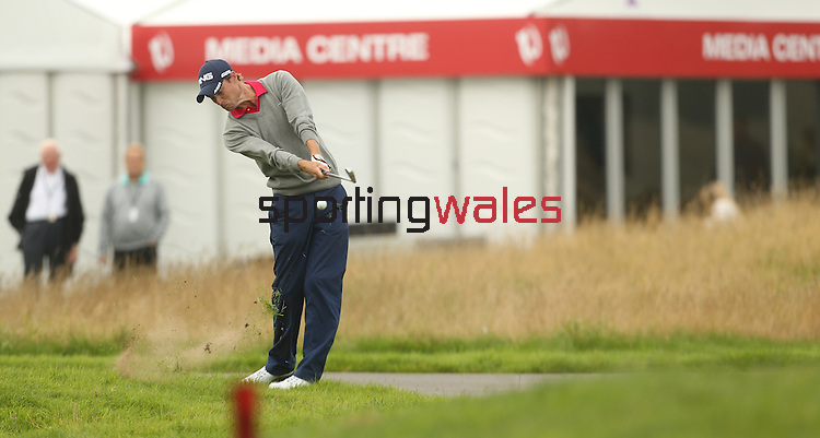 Welsh golfer Rhys Davies plays his second shot from close to the out of bounds on the first hole during the opening round of the ISPS Handa Wales Open 2013 at the Celtic Manor Resort.<br /> <br /> 29.08.13<br /> <br /> ©Steve Pope-Sportingwales
