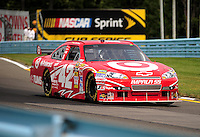 Aug. 8, 2009; Watkins Glen, NY, USA; NASCAR Sprint Cup Series driver Juan Pablo Montoya during practice for the Heluva Good at the Glen. Mandatory Credit: Mark J. Rebilas-