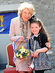 Jodi Kenneally aged 9, neice of Michael Quinn presents a gift to Sabina Higgins wife of President Michael D Higgins at the unveiling of the plaque. Photo: Colin Bell/pressphotos.ie