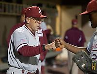 SANTA CLARA, CA - April 19, 2011: Head coach Mark Marquess of Stanford baseball bumps fists with Brian Ragira after Stanford's game against Santa Clara at Stephen Schott Stadium. Stanford won 10-3.
