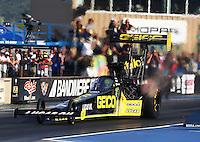 Jul. 18, 2014; Morrison, CO, USA; NHRA top fuel driver Richie Crampton during qualifying for the Mile High Nationals at Bandimere Speedway. Mandatory Credit: Mark J. Rebilas-