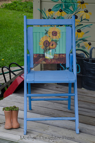 Painted blue chair on porch of painted shed, Yarmouth Community Garden, Maine, USA