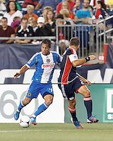 Philadelphia Union midfielder Daniel Cruz (44) dribbles. New England Revolution defender Flo Lechner (2) defends. In a Major League Soccer (MLS) match, the New England Revolution tied Philadelphia Union, 0-0, at Gillette Stadium on September 1, 2012.