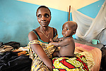 A mother and her ill child in a clinic of the United Methodist Church in Kananga, a town in the Democratic Republic of the Congo.