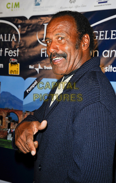 "FRED WILLIAMSON .Arriving at a special screening of ""Inglourious Basterds"" at the Opening Night Gala of the 5th Annual Los Angeles, Italia Film, Fashion and Art Fest at the Mann Chinese Theatre in Hollywood, California, USA,.February 28th, 2010..half length hand finger blue suit side pointing moustache mustache facial hair  .CAP/ROT.©Lee Roth/Capital Pictures"