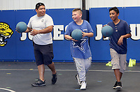 NWA Democrat-Gazette/DAVID GOTTSCHALK  Patrolman First Class Leonel Ramirez (from left), with the Springdale Police Department, lines up with Maurice Olvera, 11, and Pedro Perez, 12, Tuesday, June 13, 2017, during a game of dodge ball at Jones Elementary School in Springdale. The students are participating in the department's Sandlot Program that enables school resource officers to play, hangout and participate in different activities with school age students at the different schools in the district. The students also participate in the Free Summer Lunch Program through Springdale Public Schools. This week officers are at Bayyari, Elmdale and Jones Elementary School.