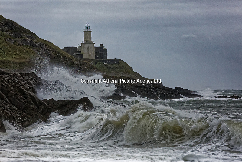 Pictured: Waves crash against rocks by Mumbles lighthouse in Bracelet Bay, Swansea, Wales, UK. Thursday 20 September 2018<br /> Re: Heavy rain and strong winds brought by Storm Bronagh has hit parts of the UK.