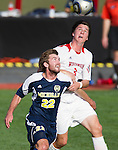 Wisconsin Badgers Kyle McCrudden (3) battles for the ball during an NCAA soccer game against the Michigan Wolverines at the McClimon Memorial Track/Soccer Complex in Madison, Wisconsin on October 10, 2010. Michigan beat Wisconsin 3-2. (Photo by David Stluka)