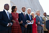 "United States President Barack Obama, First Lady Michelle Obama, U.S. Vice President Joe Biden and Dr. Jill Biden link arms and sing ""We Shall Overcome"" during the dedication ceremony for the Martin Luther King Jr. National Memorial in Washington, D.C., Sunday, Oct. 16, 2011. Joining them, from left, are: Harry Johnson, Sr.; U.S. Secretary of the Interior Ken Salazar; and Herman ""Skip"" Mason. (Official White House Photo by Pete Souza)..This official White House photograph is being made available only for publication by news organizations and/or for personal use printing by the subject(s) of the photograph. The photograph may not be manipulated in any way and may not be used in commercial or political materials, advertisements, emails, products, promotions that in any way suggests approval or endorsement of the President, the First Family, or the White House. .Mandatory Credit: Pete Souza - White House via CNP"