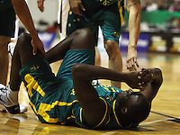 Boomers forward Nathan Jawai goes down after a collision during the International basketball match between the NZ Tall Blacks and Australian Boomers at TSB Bank Arena, Wellington, New Zealand on 25 August 2009. Photo: Dave Lintott / lintottphoto.co.nz