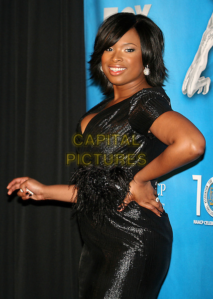 JENNIFER HUDSON .40th Annual NAACP Image Awards - Press Room at the Shrine Auditorium, Los Angeles, California, USA..February 12th, 2009.half length black blue feathers waist silver circle globe earrings shiny wrap dress hand on hip cleavage.CAP/ADM/BP.©Byron Purvis/AdMedia/Capital Pictures.